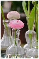 flowers on small             vase by bloeming business